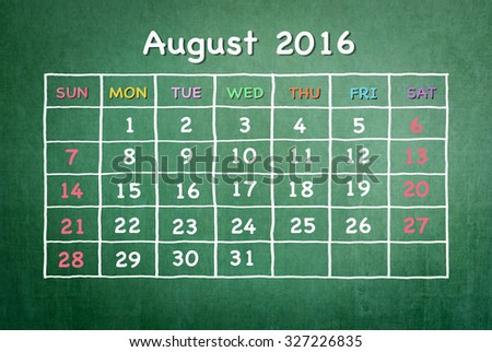August 2016: Monthly calendar on green chalkboard background with colorful pastel day and dates in freehand grid time table chalk drawing: School/ business time planner conceptual idea for new year