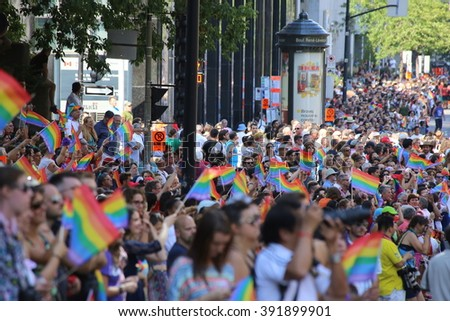 August 18, 2013 - Montreal, Quebec, Canada - Gay Pride Parade moves along Boulevard Rene Levesque. - stock photo