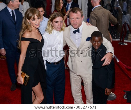 """August 10, 2015, New York, New York, USA - David Ciccone Ritchie, Guy Ritchie, Rocco Ritchie and Jacqui Ainsley attend the New York City premiere of """"The Man From U.N.C.L.E."""" at the Ziegfeld Theater - stock photo"""