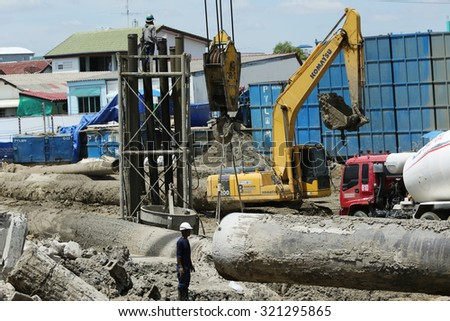 AUGUST 30, 2015 ; NONTHABURI - THAILAND : Concrete boring pile foundation under-construction in process with heavy equipment at Eletricity generating authority of Thailand, Nonthaburi province.