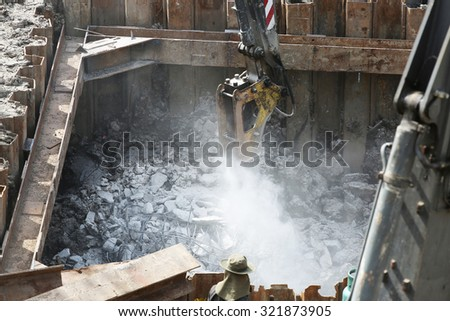 AUGUST 30, 2015 ; NONTHABURI - THAILAND : Piling work of concrete foundation under-construction and cutting of piles tip.
