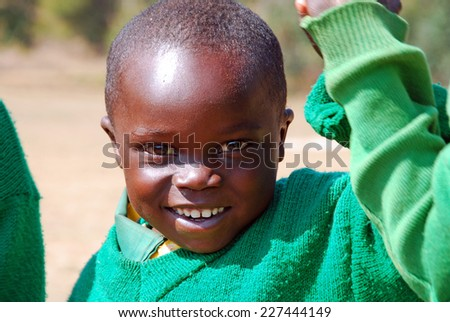August 2014 -Pomerini - Tanzania - Africa - The game of African children of kindergarten of the Franciscan Mission built by the non-profit organization Mawaki in the Village of Pomerini in Tanzania - stock photo