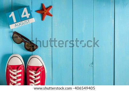 August 14th. Image of august 14 wooden color calendar on blue background. Summer day. Empty space for text - stock photo