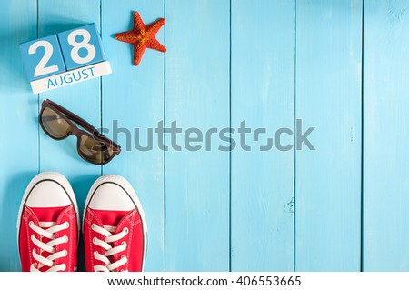 August 28th. Image of august 28 wooden color calendar on blue background. Summer day. Empty space for text - stock photo