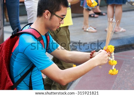 August 23, 2015 : The Brahma statue after terror attack and bomb explosion in Ratchaprasong on August 17, 2015 Bangkok, Thailand. Erawan shrine reopens again for victims family and people mourn. - stock photo