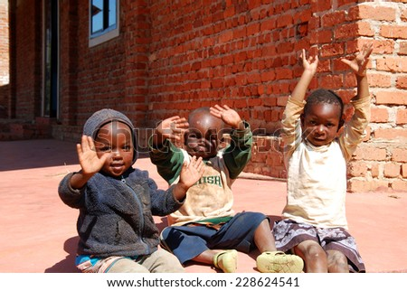 August 2014-Village of Pomerini-Tanzania-Africa- African children of the Franciscan Mission of the Village of Pomerini, high-risk country hit by the virus of HIV-AIDS  - stock photo