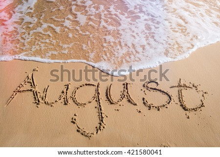 August written on beach, end of summer concept - stock photo
