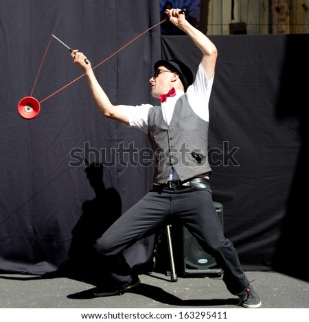 AURILLAC, FRANCE - AUGUST 22: Actor playing diabolo as part of the Aurillac International Street Theater Festival, Cie Kiblos,on august 22, 2013, in Aurillac,France  - stock photo