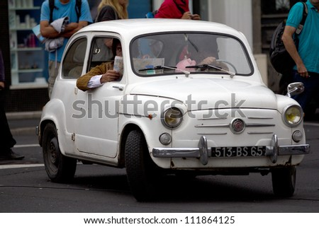 AURILLAC, FRANCE - AUGUST 24 : actors in an old car as part of the Aurillac International Street Theater Festival,show by the Company En Estafette , on august 24, 2012, in Aurillac,France. - stock photo