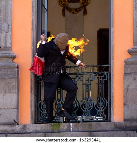 AURILLAC, FRANCE - AUGUST 21: Portrait of an actor on fire  as part of the Aurillac International Street Theater Festival,Spectacle d'Ouverture,on august 21, 2013, in Aurillac,France  - stock photo