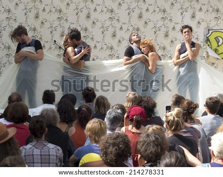 AURILLAC, FRANCE-AUGUST 21: three couples of actors  play the romantic relationships as part of the  Aurillac International Street Theater Festival, cie Berthe,on august 21, 2014, in Aurillac,France.  - stock photo