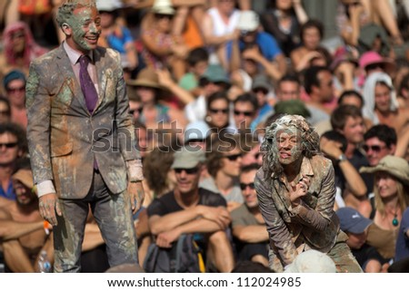 AURILLAC, FRANCE - AUGUST 22: two actors move as zombies as part of the Aurillac International Street Theater Festival,show by the Company n�°8 ,on august 22, 2012, in Aurillac,France. - stock photo