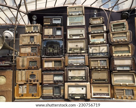 AURILLAC, FRANCE, AUGUST 21: you can see a wall of retro radio sets in the street as part of the Aurillac international Street Theater Festival, on august 21, 2014 in Aurillac, France. - stock photo