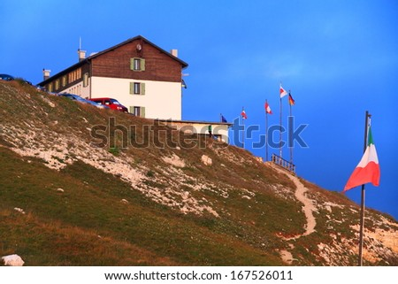 Auronzo refuge and nearby flags, Dolomite Alps, Italy - stock photo