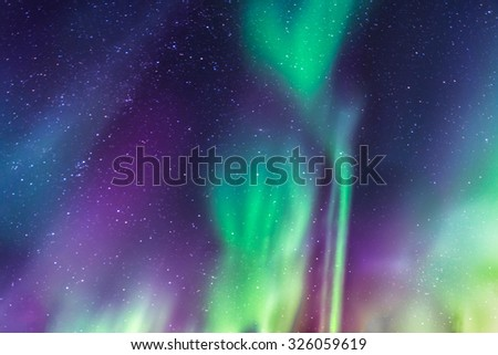 Aurora Borealis a starry sky in the north of Sweden - stock photo
