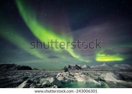 Aurora Borealis - frozen Arctic landscape - stock photo