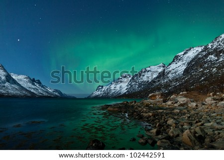 Aurora Borealis in Norway with reflection - stock photo