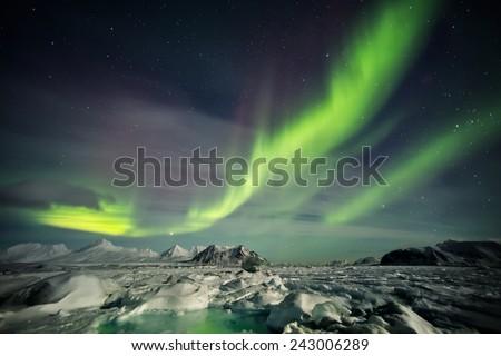 Aurora Borealis - landscape of the Arctic - stock photo