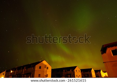 Aurora borealis. Northern Lights over the farmhouses in Northern Europe. 2015, March 17-18 - stock photo