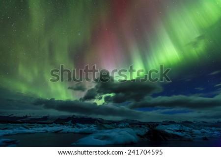 Aurora borealis over Jokulsarlon lagoon in Iceland - stock photo