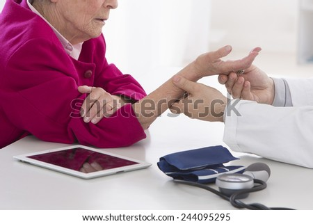 Auscultation senior woman for wrist pain - stock photo