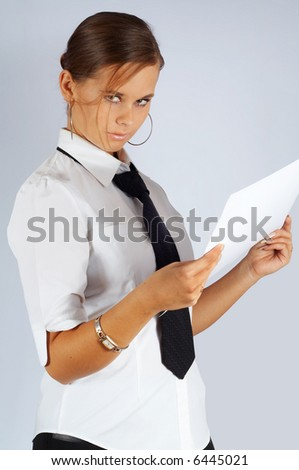 austere secretary with a draft - stock photo