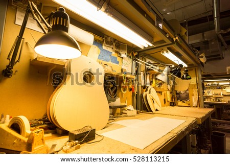 AUSTIN - CIRCA OCTOBER 2015: A work bench is used to manufacture guitars.