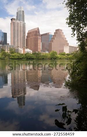 Austin City Skyline Under First Street Bridge Colorado River - stock photo