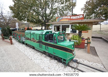 AUSTIN, TEXAS - DECEMBER 7: The Zilker Zephyr train is parked at the train station on December 7, 2010 in Zilker Park, Austin, Texas. The Zephyr takes riders on a scenic ride around Zilker park. - stock photo
