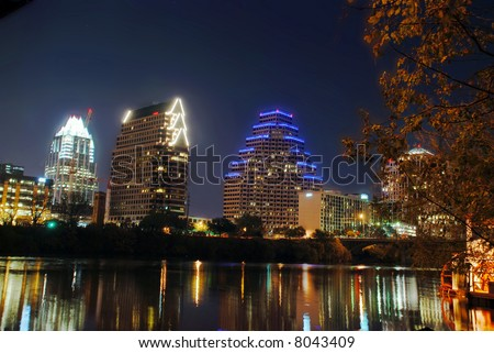 Austin, Texas downtown city skyline during the December holidays with its lights reflecting on the water of Townlake - stock photo