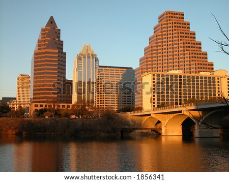 Austin, Texas downtown skyline at sunset, embraced by the beauty of nature. Austin downtown is next to the colorado river\'s infamous Town Lake. - stock photo
