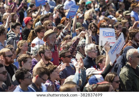 AUSTIN, TEXAS - FEBRUARY 27, 2016: A crowd of Bernie Sanders supporters wave signs while listening to Senator Sanders speak at a campaign rally at the Circuit of the Americas.