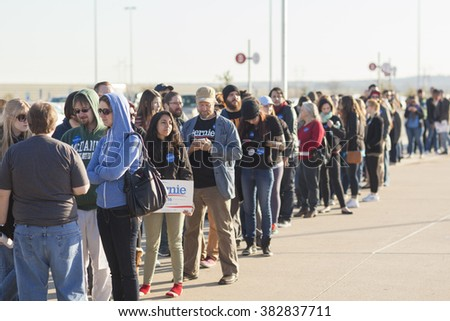 AUSTIN, TEXAS - FEBRUARY 27, 2016: A long line of people wait patiently at the entry to a campaign rally for Senator Bernie Sanders at the Circuit of the Americas. - stock photo