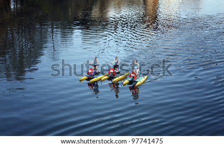 AUSTIN, TEXAS - MAR 9: SXSW 2012 South by Southwest 2012 Annual music, film, and interactive conference and festival on March 9, 2012 in Austin, Texas. Festival is held from March 9-18. Water bicycles on Colorado river during SXSW - stock photo