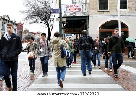 AUSTIN, TEXAS - MAR 9: SXSW 2012 South by Southwest 2012 Annual music, film, and interactive conference and festival on March 9, 2012 in Austin, Texas. Festival is held from March 9-18. Street pedestrians - stock photo