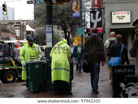 AUSTIN, TEXAS - MAR 9: SXSW 2012 South by Southwest 2012 Annual music, film, and interactive conference and festival on March 9, 2012 in Austin, Texas. Festival is held from March 9-18. Street workers - stock photo