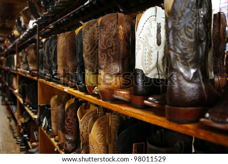 AUSTIN, TEXAS - MAR 9: SXSW 2012 South by Southwest 2012 Annual music, film, and interactive conference and festival on March 9, 2012 in Austin, Texas. Festival is held from March 9-18. Cowboy boots - stock photo