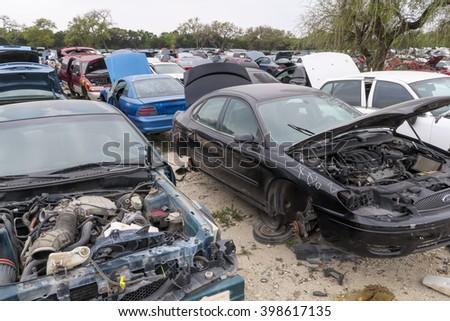 AUSTIN, TEXAS â?? MARCH 16 2016: pretty clean black Ford car for being in a junkyard - stock photo