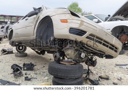 AUSTIN, TEXAS â?? MARCH 16 2016: this car is balanced at on top of more junk - stock photo