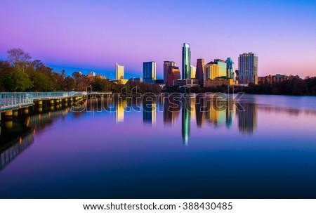Austin Texas morning Glow from Riverside pedestrian Bridge purple and pink colorful sunrise - stock photo