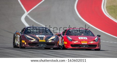 AUSTIN, TEXAS - NOVEMBER 17.  Drivers compete during the Ferrari Challenge race at the Circuit of The America's race track on November 17, 2013 in Austin, Texas. - stock photo