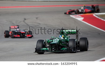 AUSTIN, TEXAS � NOVEMBER 16.  Team Caterham leading two other cars in the Formula One Qualifying Session at the Circuit of the America's race track on November 16, 2013 in Austin, Texas. - stock photo