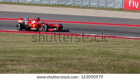 AUSTIN, TEXAS -Â?Â? NOVEMBER 15.  Team Ferrari on the first day of Formula One practice session at the Circuit of the America's race track on November 15, 2013 in Austin, Texas. - stock photo