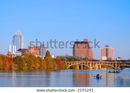 Austin Texas skyline along the Colorado river. - stock photo