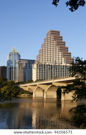 Austin, Texas skyline, Lady Bird Lake and Congress Avenue Bridge. This barrel-arched bridge with its open construction was built in 1910 and is an Austin landmark. - stock photo