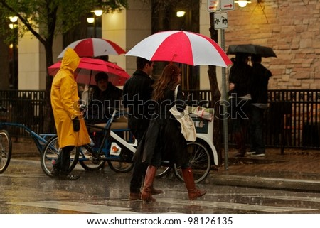 AUSTIN, TX - MAR 9: SXSW Interactive Conference on March 9, 2012 in Austin. Rain does not slow down the SXSW conference. - stock photo
