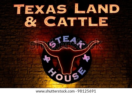 Austin, TX - March 8: The Night before SXSW Interactive Conference in Austin. Texas Land and Cattle is a popular restaurant. - stock photo