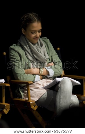 AUSTIN,TX - OCTOBER 24: Smiling Actress Jessica Alba reads ' The Hand Job ' Script at the Rollins Theatre during the 17th Annual Austin Film Festival on October 24, 2010 in Austin, TX. - stock photo