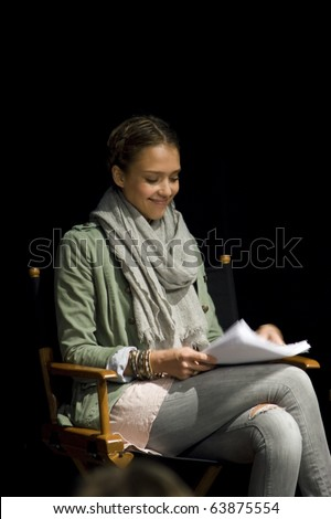 AUSTIN,TX - OCTOBER 24: Smiling Jessica Alba reads ' The Hand Job ' Script at the Rollins Theatre during the 17th Annual Austin Film Festival on October 24, 2010 in Austin, TX. - stock photo
