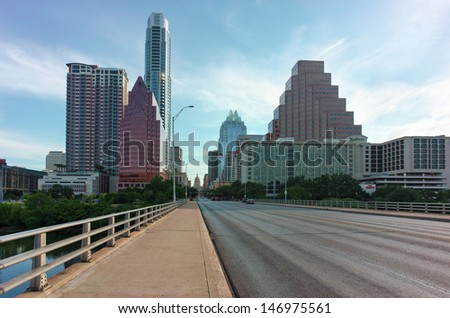AUSTIN,TX/USA - JULY 11 Downtown Austin, Texas showing the State Capitol building at the end of the street on July 09, 2013. Austin is experiencing a population explosion since the 2008 crash. - stock photo